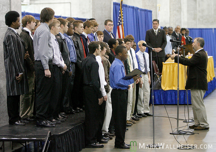 Scott Leaman, right, leads the Lincoln High School's Men Chorale at the Dr. Martin Luther King Jr. Annual Commemorative Birthday Breakfast at the Tallahassee-Leon County Civic Center January 18, 2008.   (Mark Wallheiser/TallahasseeStock.com)
