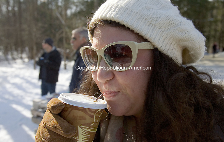 SALISBURY CT. 08 February 2014-020914SV21-Anna Sgalia of Canaan keep warm by the fire drinking hot chocolate while watching the Eastern United States Ski Jumping Championships in Salisbury Sunday. <br /> Steven Valenti Republican-American