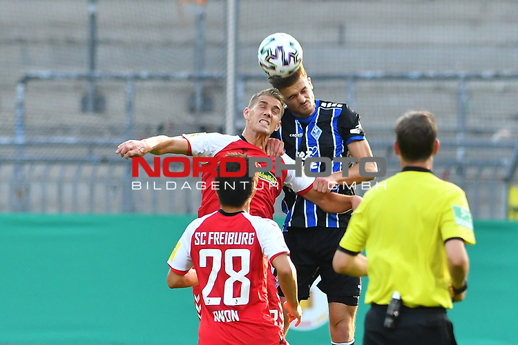 13.09.2020, Carl-Benz-Stadion, Mannheim, GER, DFB-Pokal, 1. Runde, SV Waldhof Mannheim vs. SC Freiburg, <br /> <br /> DFL REGULATIONS PROHIBIT ANY USE OF PHOTOGRAPHS AS IMAGE SEQUENCES AND/OR QUASI-VIDEO.<br /> <br /> im Bild: Nils Petersen (#18, SC Freiburg) gegen Jan Just (SV Waldhof Mannheim #22)<br /> <br /> Foto © nordphoto / Fabisch