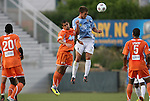 19 May 2012: Puerto Rico's Jarad van Schaik (14) heads the ball under pressure from Carolina's Austin da Luz (left). The Carolina RailHawks and the Puerto Rico Islanders played to a 1-1 tie at WakeMed Soccer Stadium in Cary, NC in a 2012 North American Soccer League (NASL) regular season game.