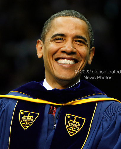 South Bend, IN - May 17, 2009 -- United States President Barack Obama reacts during the Notre Dame University 164th commencement ceremonies on the campus of Notre Dame University in South Bend, Indiana May 17, 2009. Obama received an honorary law degree from the university during the commencement. .Credit: Jeff Haynes / Pool via CNP