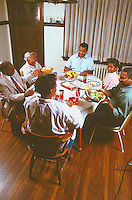 African American family with grandparents and children eating dinner.  St Paul Minnesota USA