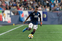FOXBOROUGH, MA - AUGUST 31: DeJuan Jones #24 of New England Revolution passes the ball during a game between Toronto FC and New England Revolution at Gillette Stadium on August 31, 2019 in Foxborough, Massachusetts.