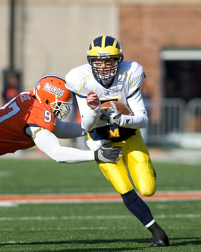 October 31, 2009 - Champaign, Illinois, USA -  Michigan quarterback Tate Forcier (5) slips past Illinois defensive lineman Clay Nurse (97) in the game between the University of Illinois and the University of Michigan at Memorial Stadium in Champaign, Illinois.  Illinois defeated Michigan 38 to 13.  ..