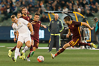 Melbourne, 18 July 2015 - Denis Cherychev of Real Madrid and Kostas Manolas of AS Roma fight for the ball in game one of the International Champions Cup match at the Melbourne Cricket Ground, Australia. Roma def Real Madrid 7-6 Penalties. Photo Sydney Low/AsteriskImages.com