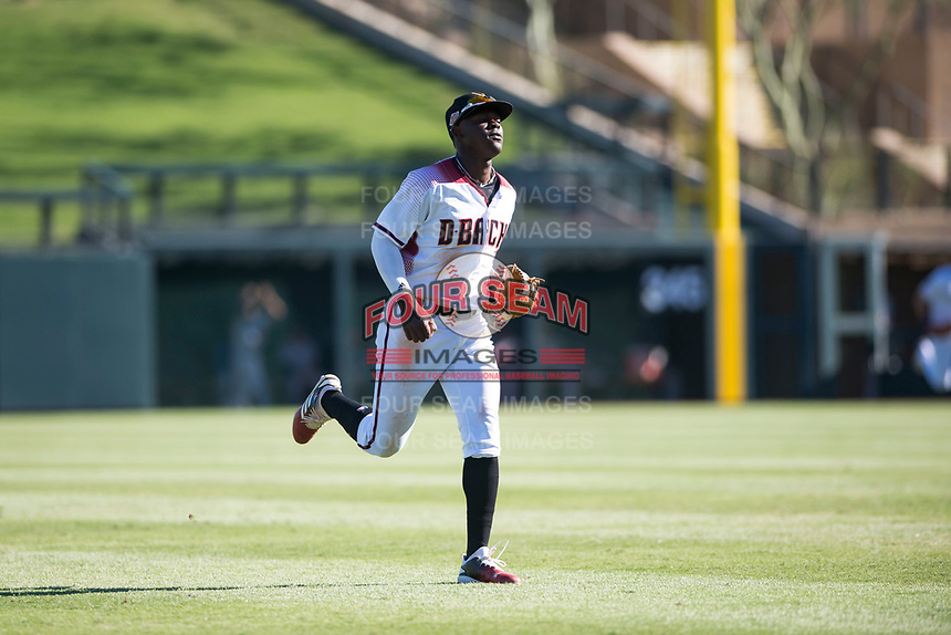 Salt River Rafters shortstop Jazz Chisholm (1), of the Arizona Diamondbacks organization, jogs off the field between innings of an Arizona Fall League game against the Glendale Desert Dogs at Salt River Fields at Talking Stick on October 31, 2018 in Scottsdale, Arizona. Glendale defeated Salt River 12-6 in extra innings. (Zachary Lucy/Four Seam Images)