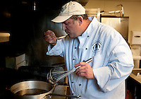 Professional Chef Ken Cobb (cq) prepares an Au Jus sauce for a prime rib dinner at Sigma Alpha Epsilon fraternity house on the Southern Methodist University campus in Dallas, Texas, Friday, january 20, 2011. Some high-end chefs have found professional salvation from an unlikely location: Fraternity Row. Cobb employs a pair of interns from the Dallas Culinary Institute, where he once served as lead instructor, to help him cook three meals every weekday for another pair of frat houses on SMU's campus...Matt Nager for The Wall Street Journal