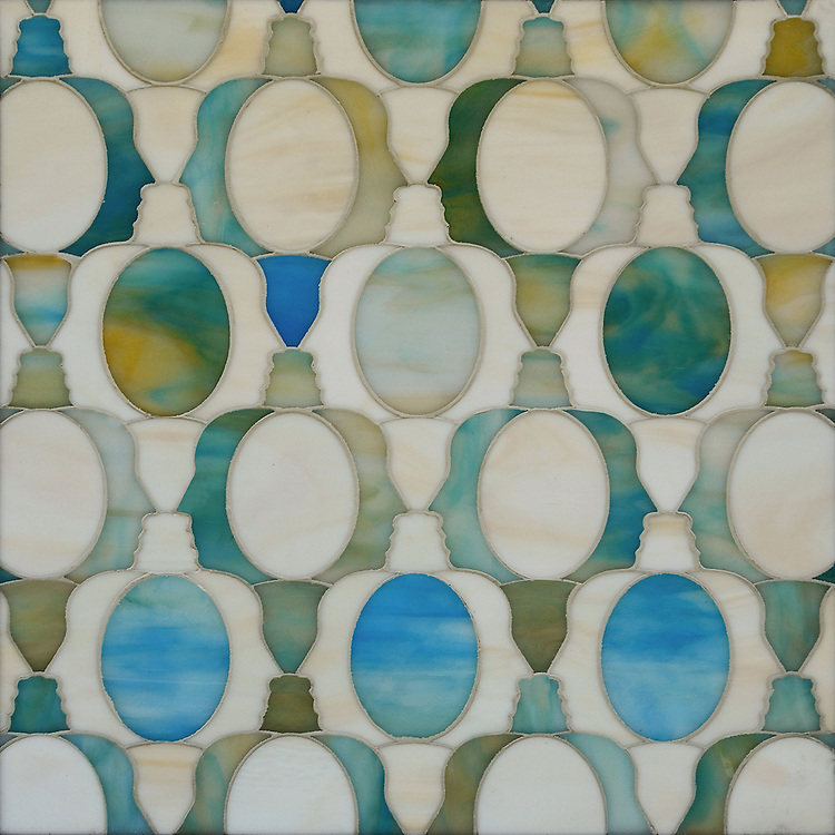 Janus Petite, a waterjet mosaic shown in Aquamarine and Quartz jewel glass, is part of the Illusions® collection by New Ravenna.