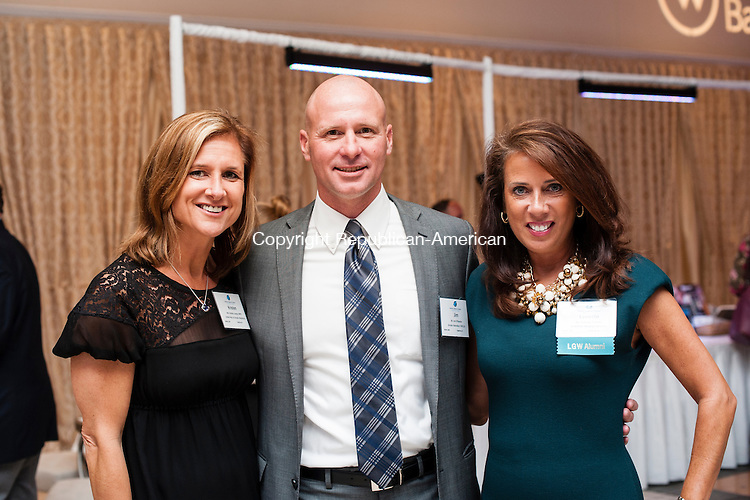 SOUTHINGTON, CT-2 October 2014-100214EC04-  Social Moments. Kristen Jacoby with the United Way, Jim O'Rourke with the YMCA, and Lynette Piombo with American Heating Services attend the annual Malcolm Baldrige awards dinner at the Aqua Turf. Catherine Smith of Middlebury received the 2014 Malcolm Baldrige Community Award, Carl Rosa of Waterbury received the 2014 Waterbury Regional Chamber Leadership Award, and Diane Ploch of Oxford received the 2014 Volunteer Award. Erin Covey Republican-American