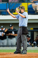 Home plate umpire Alex Ziegler signals the count during the Appalachian League game between the Bristol White Sox and the Burlington Royals at Burlington Athletic Park on July 10, 2011 in Burlington, North Carolina.  The White Sox defeated the Royals 4-3.   (Brian Westerholt / Four Seam Images)