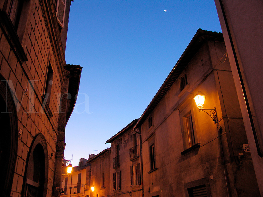 Crescent moon in sky above sleepy houses on Corso Cavour in Orvieto, Ital