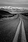 Black and white of desolate highway in Death Valley California