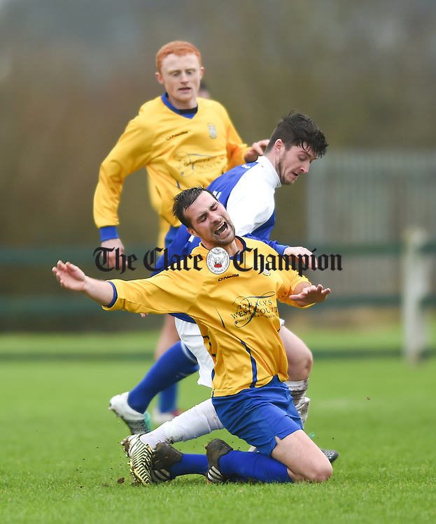 Darragh Corry of Clare in action against Paudie Quinn of Limerick during their FAI Oscar Traynor game in Limerick. Photograph by John Kelly.