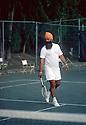 Yogi Bhajan playing tennis at the Yoga Teacher's Congress in the Bahamas in April 1975