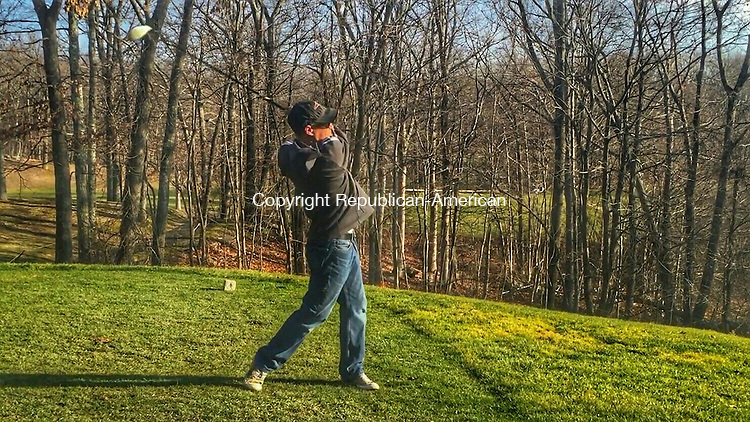 WATERBURY, CT - 10 Dec. 2015 - 121015PO01 - Chris MacKinnon makes the most of the mild start to winter with afternoon golf at Western Hills Golf Course in Waterbury Thursday. Area courses like Western Hills are lengthening seasons, and seeing increased play, because of the nice weather. Penelope Overton Republican-American