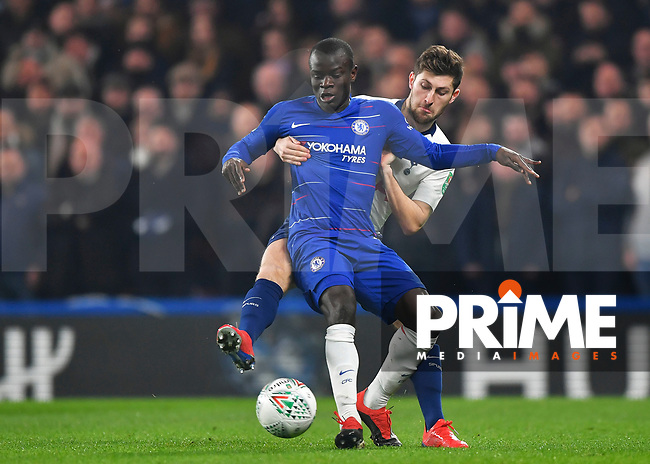 Ngolo Kanté of Chelsea battles with Ben Davies of Tottenham Hotspur during the Carabao Cup Semi-Final 2nd leg match between Chelsea and Tottenham Hotspur at Stamford Bridge, London, England on 24 January 2019. Photo by Vince  Mignott / PRiME Media Images.
