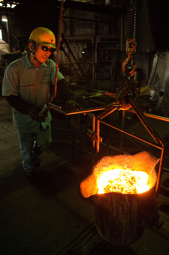 "Carrying molten iron, Oigen ""Nambu Tekki"" ironware foundry, Esashi, Iwate Prefecture, Japan, August 28 2008."
