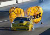 Oct. 26, 2012; Las Vegas, NV, USA: NHRA pro mod driver Troy Coughlin during qualifying for the Big O Tires Nationals at The Strip in Las Vegas. Mandatory Credit: Mark J. Rebilas-