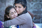 Zoya Hameed (right), a physician from the United Kingdom, hugs Hanin, a frightened Syrian refugee girl, on a beach near Molyvos, on the Greek island of Lesbos, on October 30, 2015. The girl was on a boat full of refugees that traveled to Lesbos from Turkey. The boat was provided by Turkish traffickers to whom the refugees paid huge sums to arrive in Greece. Hameed is one of hundreds of volunteers on the island who receive the refugees and provide them with warm clothing and medical care before they continue their journey toward western Europe.