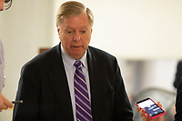 United States Senator Lindsey Graham, Republican of South Carolina, talks with reporters in the Senate Subway during a Senate vote on Capitol Hill in Washington, DC on July 7, 2018. <br /> CAP/MPI/RS<br /> &copy;RS/MPI/Capital Pictures