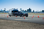 GMC Sierra trucks and airstream trailers on driver training course