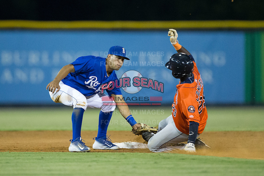 Burlington Royals shortstop Angelo Castellano (13) tags out Daz Cameron (29) of the Greeneville Astros as he tries to steal second base at Burlington Athletic Park on August 29, 2015 in Burlington, North Carolina.  The Royals defeated the Astros 3-1. (Brian Westerholt/Four Seam Images)