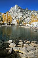Prusik Peak and rocks in Leprechaun Lake, Enchantment Lakes, Alpine Lakes Wilderness, Washingto
