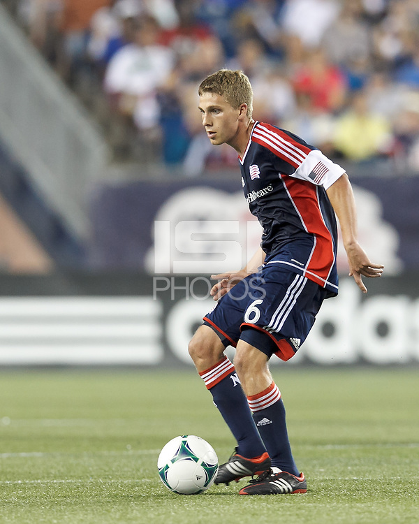 New England Revolution midfielder Scott Caldwell (6) passes the ball.  In a Major League Soccer (MLS) match, the New England Revolution (blue) defeated Chicago Fire (red), 2-0, at Gillette Stadium on August 17, 2013.