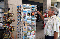 Liechtenstein  Vaduz  June 2008.Tourist you choose a postcard..