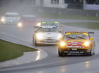A pack of cars races through the rain at the 6 Heueres du Circuit Mont-Tremblant in Mont-Tremblant, Qubec, Canada, on Saturday, May 21, 2005. (Photo by Brian Cleary/www.bcpix.com)