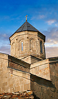 Pictures & images of Gergeti Holy Trinity (Tsminda Sameba) Georgian Orthodox and Apostolic Church cupola close up, 14th century, Gergeti, Khevi province, Georgia (country). At Sunset.
