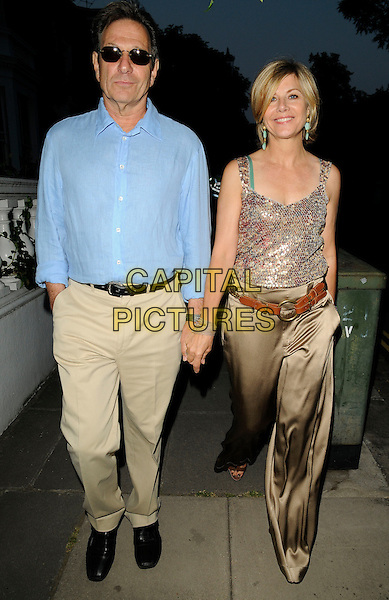 MICHAEL BRANDON & GLYNIS BARBER .Leaving Sir David Frost's Summer Party, Carlyle Square, London, England, UK,  2nd July 2009..full length blue shirt beige cream trousers bronze trousers wide leg silk satin belt holding hands sunglasses .CAP/CAN.©Can Nguyen/Capital Pictures