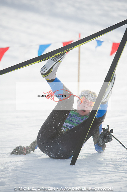 Chugiak's Emma Sees takes a spill on a turn duringt the girls 4x 3k relay Saturday.  Despite her misfortune, the Mustang girls finished second to West High. Photo by Michael DInneen for the Star.