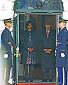 United States President Barack Obama  and first lady Michelle Obama wait to be announced in the Diplomatic Entrance of the White House to welcome President Hu Jintao of China for a State Visit on Wednesday, January 19, 2011. .Credit: Ron Sachs / CNP.(RESTRICTION: NO New York or New Jersey Newspapers or newspapers within a 75 mile radius of New York City)