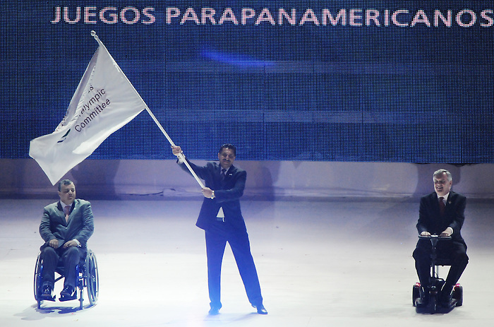 November 20 2011 - Guadalajara, Mexico:  Minister of Sport Bal Gossal receives the Americas Paralympic Committee flag during Closing Ceremonies for the 2011 Parapan American Games at the Telmex Athletics Stadium in Guadalajara, Mexico.  Photos: Matthew Murnaghan/Canadian Paralympic Committee