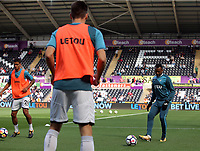 Jordan Ayew of Swansea City (R) warms up during the Premier League match between Swansea City and Watford at The Liberty Stadium, Swansea, Wales, UK. Saturday 23 September 2017