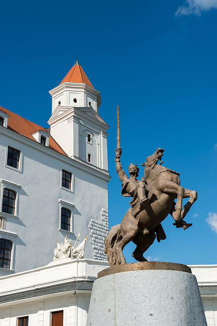 The bronze statue of Svätopluk astride his horse in front of Bratislava Castle on a hill above Bratislava, the capital of Slovakia.