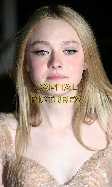 DAKOTA FANNING .New York City premiere of 'The Runaways' at Landmark Sunshine Cinema, New York City, USA, .17th March 2010..portrait headshot gold make-up .CAP/ADM/PZ.©Paul Zimmerman/AdMedia/Capital Pictures.