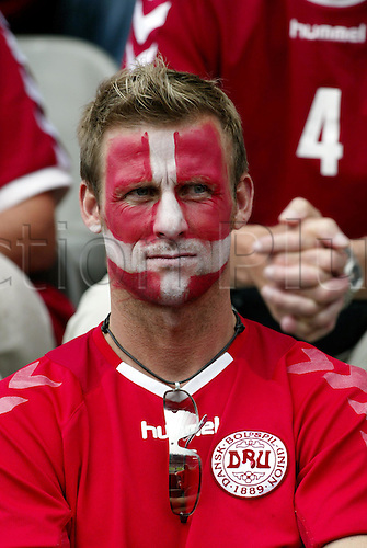 June 18, 2004: A Danish supporter with a painted face in the crowd before the Euro 2004 Group C match between Bulgaria and Denmark played at the Estadio Municipal de Braga, Braga, Portugal. Denmark won the game 2-0 Photo: Neil Tingle/Action Plus ..040618 football soccer UEFA European Championships spectator crowd supporter fan