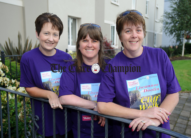 Michelle Barrett, Tine Mc Carthy and Niamh Mc Mahon  about to catch the bus for the Weightwatchers/Clare Champion Liscannor to Cliffs of Moher coastal walk. Photograph by John Kelly.
