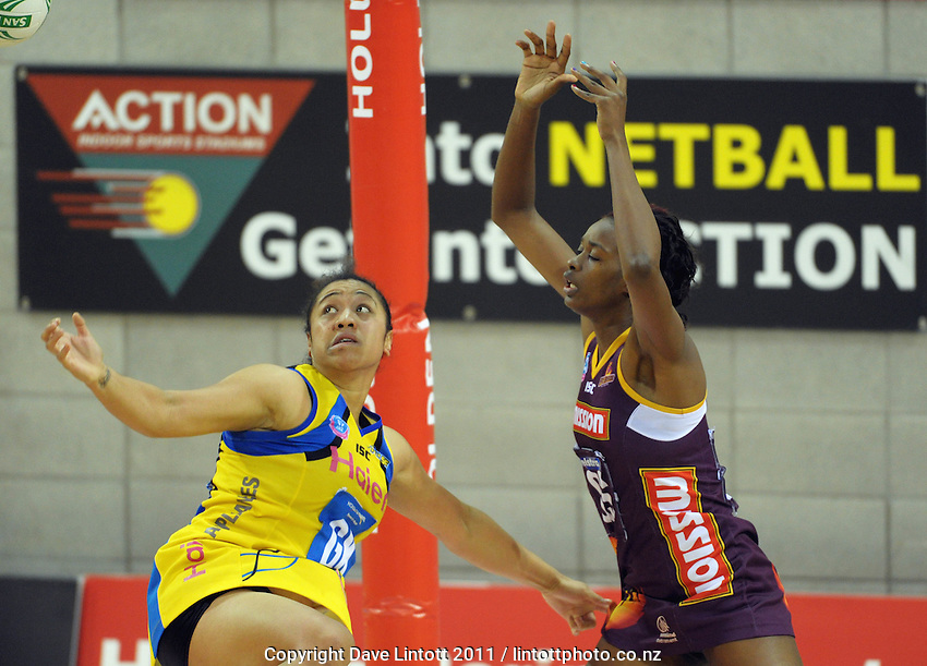 Pulse goalkeep Bessie Manu competes with Romelda Aiken for the ball. ANZ Netball Championship - Central Pulse v Queensland Firebirds at Te Rauparaha Arena, Porirua, Wellington, New Zealand on Sunday, 10 April 2011. Photo: Dave Lintott / lintottphoto.co.nz