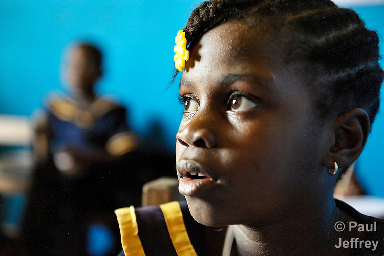 A girl listens to the teacher during class in a day care center in Monrovia, Liberia, sponsored by United Methodist Women.