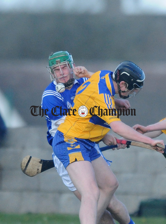Sean Collins of Cratloe runs into the challenge of Sixmilebridge's Shane Golden. Photograph by Declan Monaghan