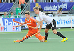 The Hague, Netherlands, June 06: Mats Grambusch #8 of Germany and Jelle Galema #20 of The Netherlands battle for the ball during the field hockey group match (Men - Group B) between Germany and The Netherlands on June 6, 2014 during the World Cup 2014 at Kyocera Stadium in The Hague, Netherlands. Final score 0-1 (0-1) (Photo by Dirk Markgraf / www.265-images.com) *** Local caption ***