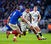 10th February 2019, Twickenham Stadium, London, England; Guinness Six Nations Rugby, England versus France; Nathan Hughes of England powers past Louis Picamoles of France