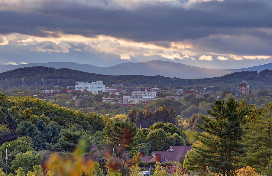 A skyline view of Downtown and mountains surrounding Charlottesville, VA. Photo/Andrew Shurtleff