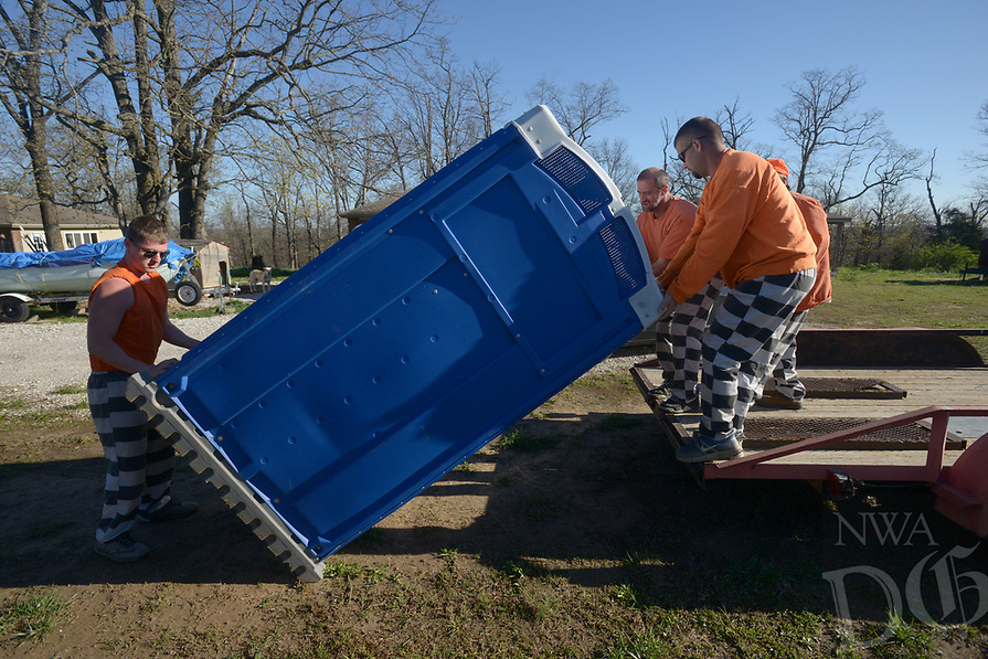 NWA Democrat-Gazette/BEN GOFF @NWABENGOFF<br /> A work detail from the Benton County Jail picks up donated portable restrooms Friday, April 7, 2017, at the property of Sharon Whelchel in Garfield. Whelchel was donating the units for the work details to use, having previously owned a portable restroom business.
