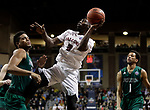 SIOUX FALLS, SD: MARCH 25:  Matt Bingaya #2 of Fairmont State shoots past Northwest Missouri State defenders D'Vante Mosby #30 and Justin Pitts #1 during the Men's Division II Basketball Championship game on March 25, 2017 at the Denny Sanford Premier Center in Sioux Falls, SD. (Photo by Dick Carlson/Inertia)