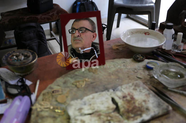 A Palestnian goldsmith Nicolae Terzi, 62, makes jewellery at his workshop, in Khan Younis in the southern of Gaza strip, on February 14, 2019. Terzi has  jewellery-making skills as he trained in the profession in Italy since 24 years. Photo by Ashraf Amra