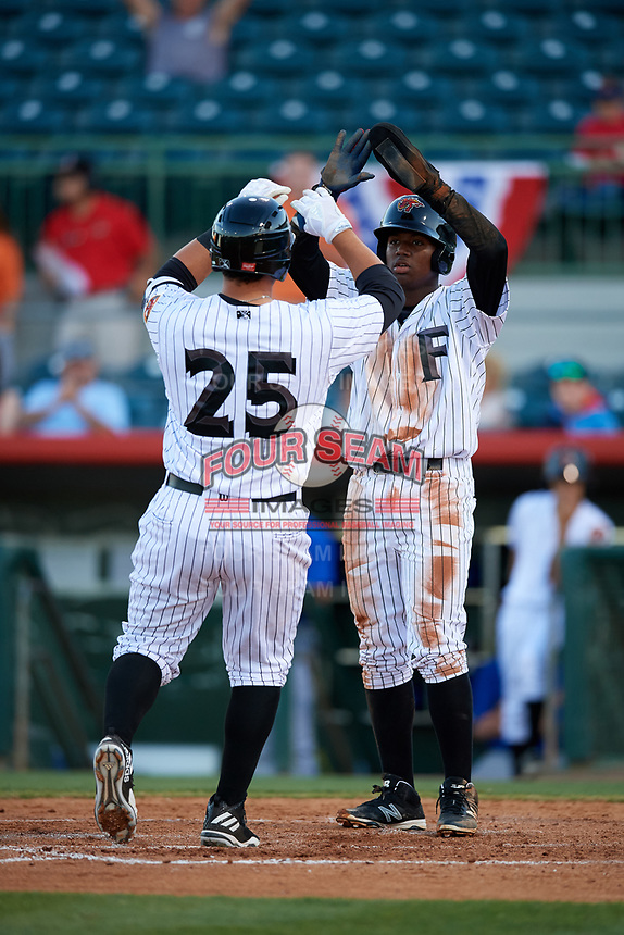 Florida Fire Frogs catcher Alex Jackson (25) is congratulated by Ronald Acuna (27) as he crosses home plate after hitting a home run in the bottom of the fourth inning during a game against the Dunedin Blue Jays on April 10, 2017 at Osceola County Stadium in Kissimmee, Florida.  Florida defeated Dunedin 4-0.  (Mike Janes/Four Seam Images)